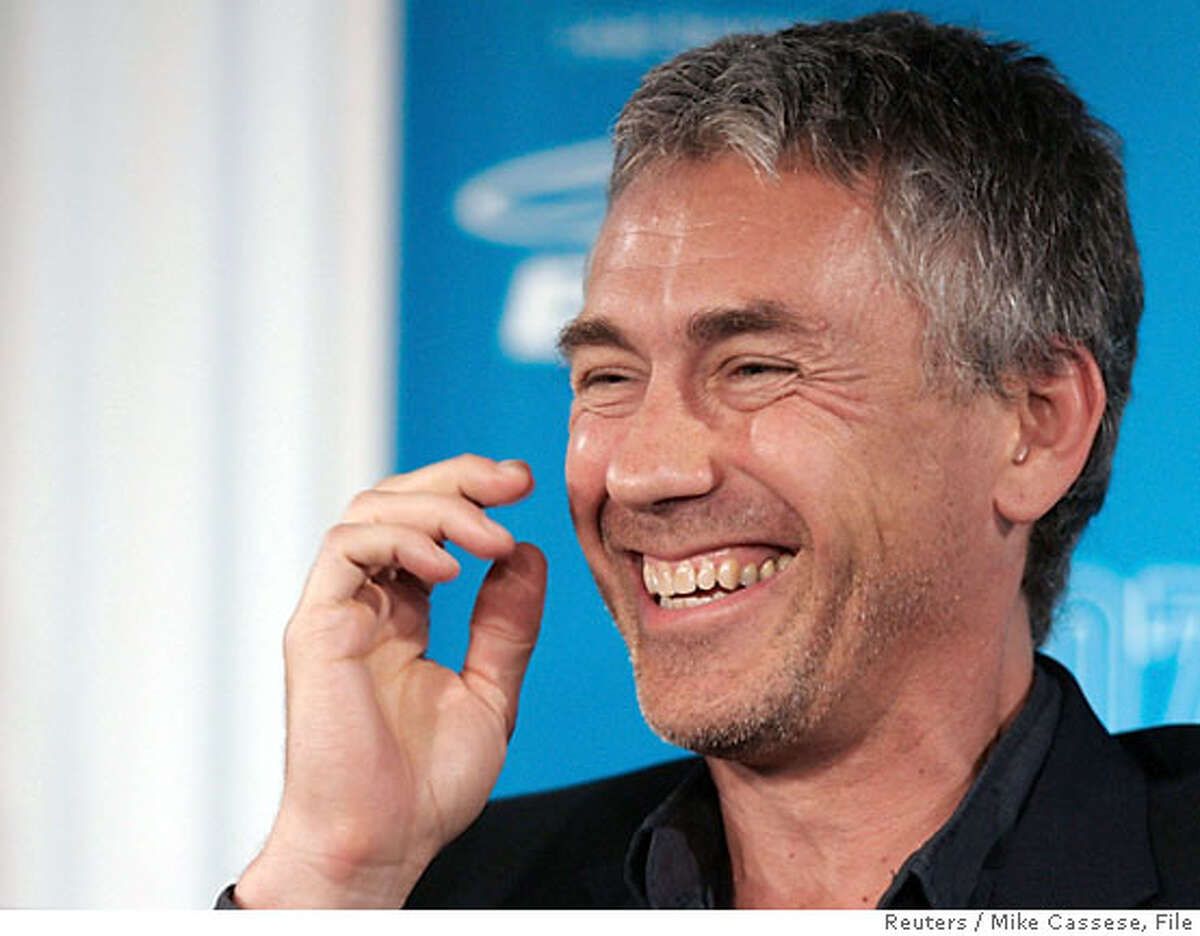 Director Tony Gilroy laughs during the news conference for
