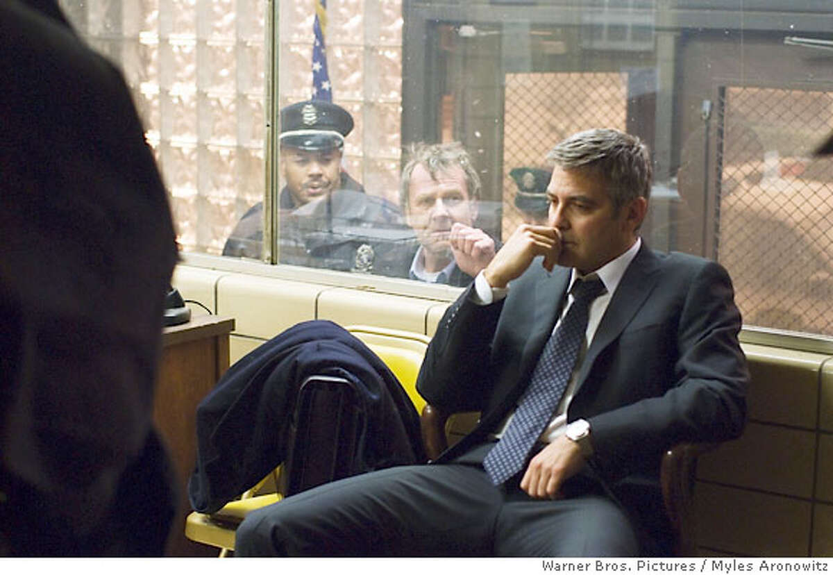 TOM WILKINSON as Arthur Edens and GEORGE CLOONEY as Michael Clayton in Warner Bros. Pictures, Samuels Media and Castle Rock Entertainment�s drama �Michael Clayton,� distributed by Warner Bros. Pictures. PHOTOGRAPHS TO BE USED SOLELY FOR ADVERTISING, PROMOTION, PUBLICITY OR REVIEWS OF THIS SPECIFIC MOTION PICTURE AND TO REMAIN THE PROPERTY OF THE STUDIO. NOT FOR SALE OR REDISTRIBUTION.
