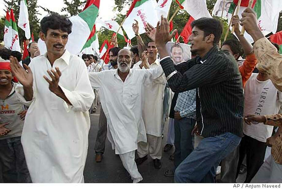 Supporters of Pakistan's President Gen. Pervez Musharraf celebrate victory of their leader in the Presidential election on Saturday, Oct 6, 2007 in Islamabad, Pakistan. Unofficial results showed Pakistan's Gen. Pervez Musharraf sweeping Saturday's presidential election, but the Supreme Court could still disqualify the military leader. (AP Photo/Anjum Naveed) Photo: Anjum Naveed