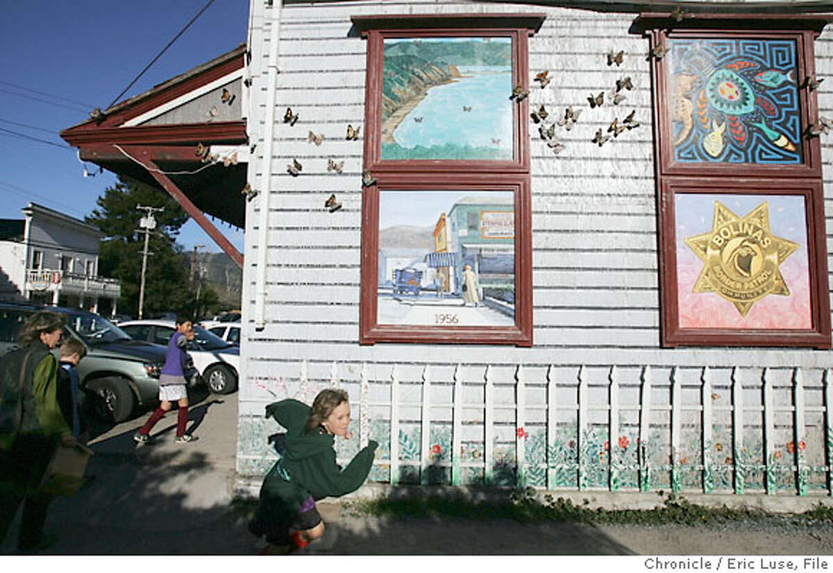 bolinas_1139_el.JPG Orie Johnson-Young,8, running alongside murals outiside the Bolinas grocery store Bolinas and it's present personality Photographer: Eric Luse / The Chronicle names cq from source