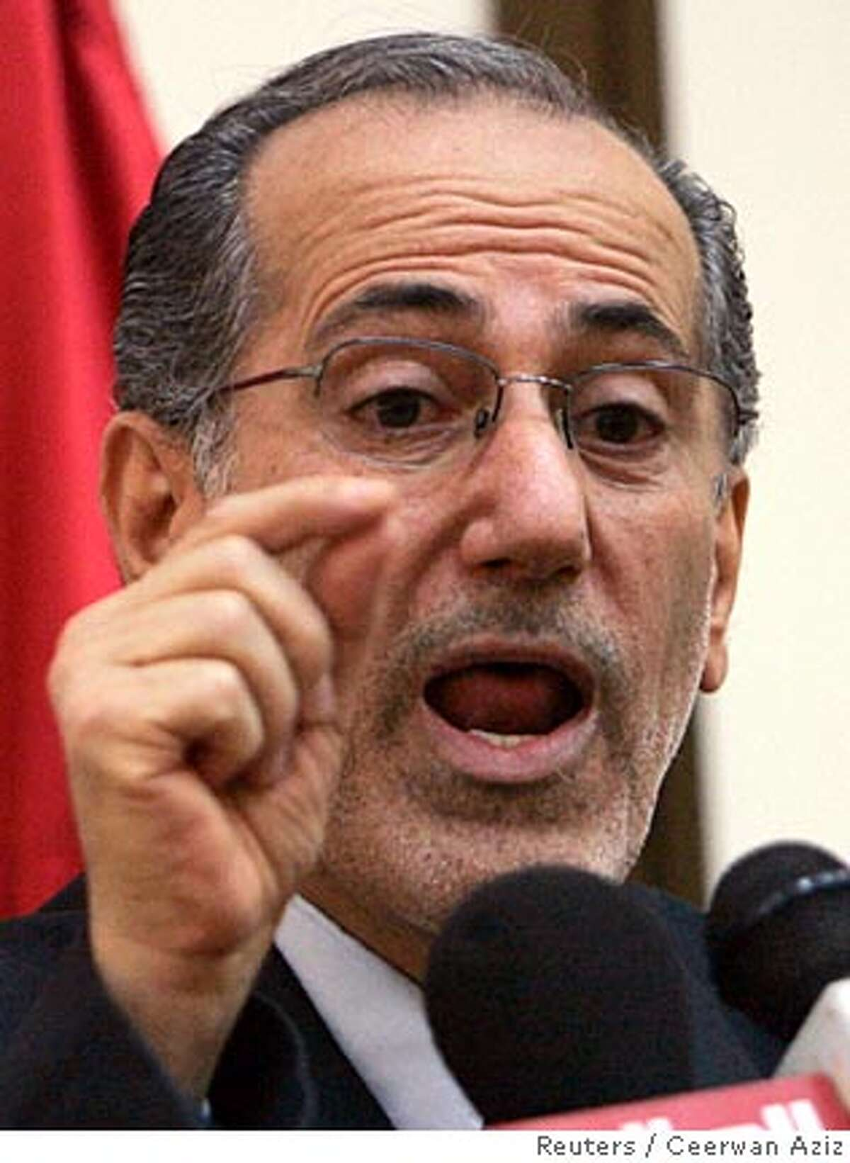 Iraq's National Security Advisor Mowaffaq al-Rubaie speaks during a news conference in Baghdad September 19, 2007. REUTERS/Ceerwan Aziz (IRAQ) Ran on: 10-06-2007 Iraqs National Security Adviser Mowaffak al Rubaie says Iran is interfering. Ran on: 10-06-2007