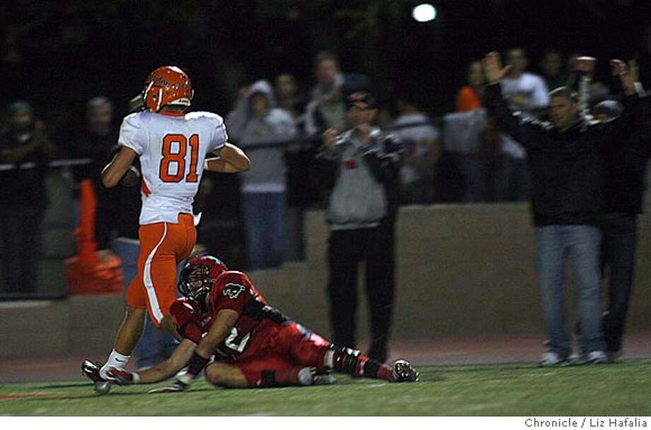 MONTE_VISTA06_139_LH.JPG  California High School (San Ramone) vs. Monte Vista High School (Danville). Cal's #81 Camden Cook makes a touchdown during the fourth quarter. Monte Vista's #12 Drew McAllister tries to tackle.  Liz Hafalia/The Chronicle/Danville/10/6/07  ** cq Ran on: 10-06-2007  Camden Cook of California (81) scores a fourth-quarter touchdown Friday night in the win over Monte Vista.  Ran on: 10-06-2007  California's Camden Cook (81) scores the game-winning touchdown on a halfback pass that went for 56 yards. Photo: Liz Hafalia