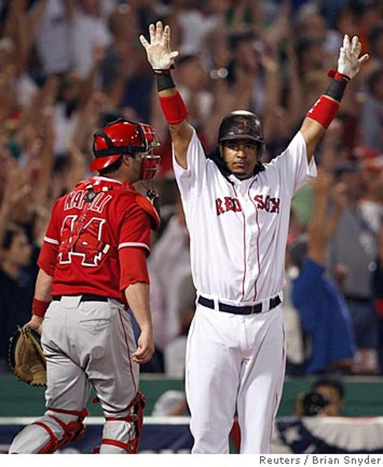 Boston Red Sox batter Manny Ramirez reacts after hitting a walk off three-run home run against the Los Angeles Angels of Anaheim during the ninth inning in Game 2 of their MLB American League Division Series playoff baseball game in Boston, October 5, 2007. REUTERS/Brian Snyder (UNITED STATES)  Ran on: 10-06-2007  Manny Ramirez's reaction says it all as his homer in the ninth gives the Red Sox the win.  Ran on: 10-06-2007  Manny Ramirez's reaction says it all as his homer in the ninth gives the Red Sox the win. Photo: BRIAN SNYDER