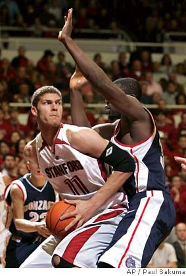 Stanford forward Brook Lopez, left, is closely guarded by Gonzaga forward Abdullahi Kuso during the second half of a basketball game in Stanford, Calif., Wednesday, Jan. 31, 2007. (AP Photo/Paul Sakuma)  Ran on: 02-01-2007  Stanford's Brook Lopez finds his way blocked by Gonzaga's Abdullahi Kuso in the second half.  Ran on: 02-01-2007  Stanford's Brook Lopez finds his way blocked by Gonzaga's Abdullahi Kuso in the second half. EFE OUT Photo: Paul Sakuma