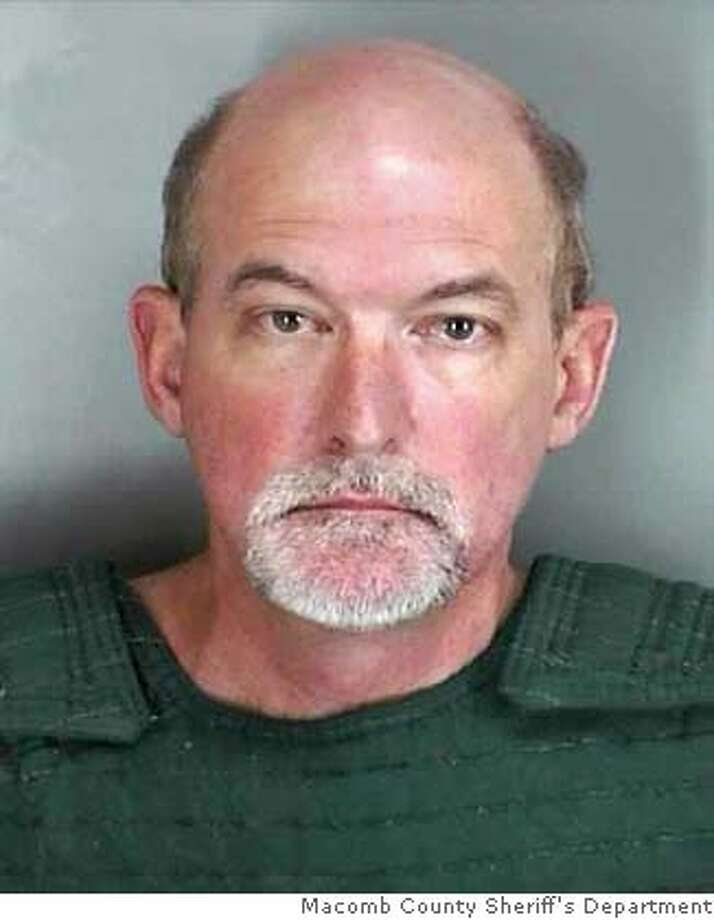 ** FILE ** In this file photo released by the Macomb County Sheriffs Department, John David R. Atchison, 53, of Gulf Breeze, Fla., is shown in Mount Clemens, Mich., Sunday, Sept. 16, 2007. Atchison, the federal prosecutor from Florida who authorities say flew to Michigan for a sexual encounter with a 5-year-old girl, committed suicide in his cell in the Milan federal prison. Atchison was found unresponsive, taken to a local hospital and pronounced dead, according to Felicia Ponce, spokeswoman for the Federal Bureau of Prisons in Washington. (AP Photo/Macomb County Sheriff's Department, FILE) PHOTO SUPPLIED BY THE MACOMB COUNTY SHERIFFS DEPT. FILE. Photo: Macomb County Sheriff's Departme