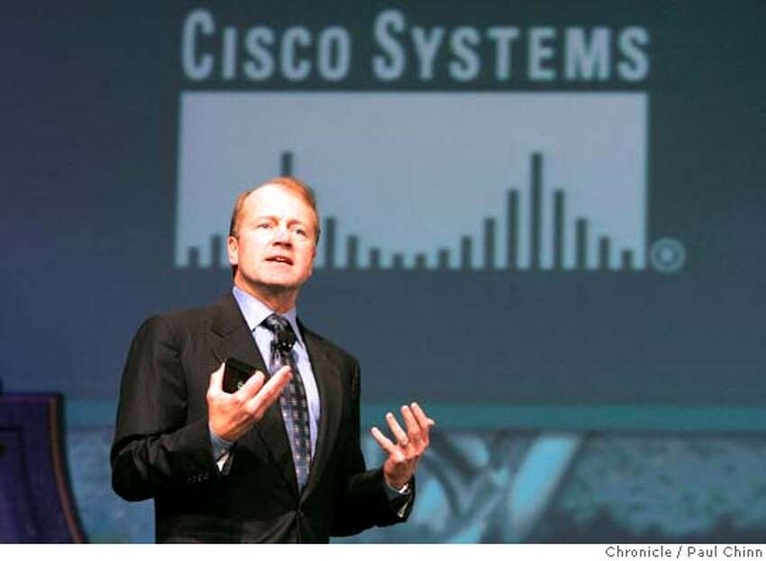 rsa17_119_pc.jpg John Chambers, president and CEO of Cisco Systems, delivers the keynote address during Tuesday morning's session. The second day of the RSA Conference on information security on 2/16/05 in San Francisco, CA. PAUL CHINN/The Chronicle Ran on: 03-09-2005 Chambers Ran on: 04-02-2005 Jerry Yang Yahoo MANDATORY CREDIT FOR PHOTOG AND S.F. CHRONICLE/ - MAGS OUT