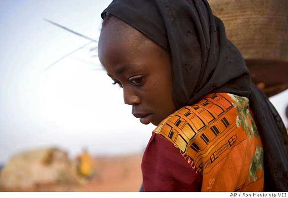 A young girl is seen at a Derainge camp outside the regional capital of Nyala, June 2, 2005. About 5,000 internally displaced persons, IDPs, have been living at the camp for more than one year. Children up to the age of 13 attend schools in two shifts due to a shortage of classrooms and teachers.(AP Photo/Mandatory Credit: Ron Haviv/VII) MANDATORY CREDIT:RON HAVIV/VII SPECIAL EDITORIAL RATES APPLY. PLEASE CONTACT YOUR AP REPRESENTATIVE FOR MORE INFORMATION. Photo: RON HAVIV