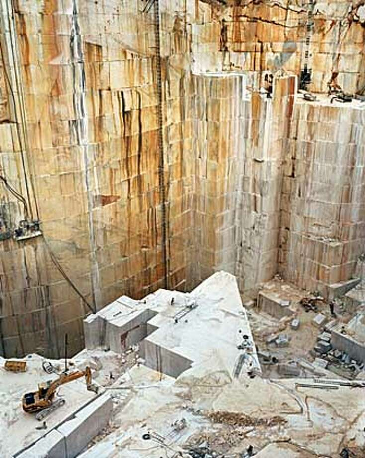 """Caption: """"Iberia Quarries #9, Cochicho Co., Pardais, Portugal"""" (2006) chromogenic print by Edward Burtynsky Burtynsky print is 48"""" x 60"""" Courtesy of Robert Koch Gallery, San Francisco  Ran on: 10-06-2007  &quo;Iberia Quarries #9, Cochicho Co., Pardais, Portugal&quo; (2006, 48 by 60 inches), chromogenic print by Edward Burtynsky, top; and, above, &quo;Glass Pavilion Drag&quo; (2007) pigment and oil paint on canvas by Gary Simmons; 18� by 94 inches. Photo: -"""