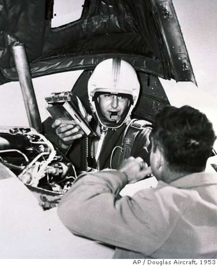 ** FILE ** Test Pilot Scott Crossfield is shown in this Nov. 20, 1953 file photo. A single-engine airplane registered to legendary test pilot Crossfield, the first man to fly at Mach 2 and Mach 3, was missing Thursday, April 20, 2006, a day after it left Alabama for the Washington, D.C., area. The plane was last spotted on radar Wednesday in Georgia, north of Atlanta, the Civil Air Patrol's Georgia Wing said. (AP Photo/Douglas Aircraft, file) NOV. 20, 1953 FILE PHOTO Photo: M