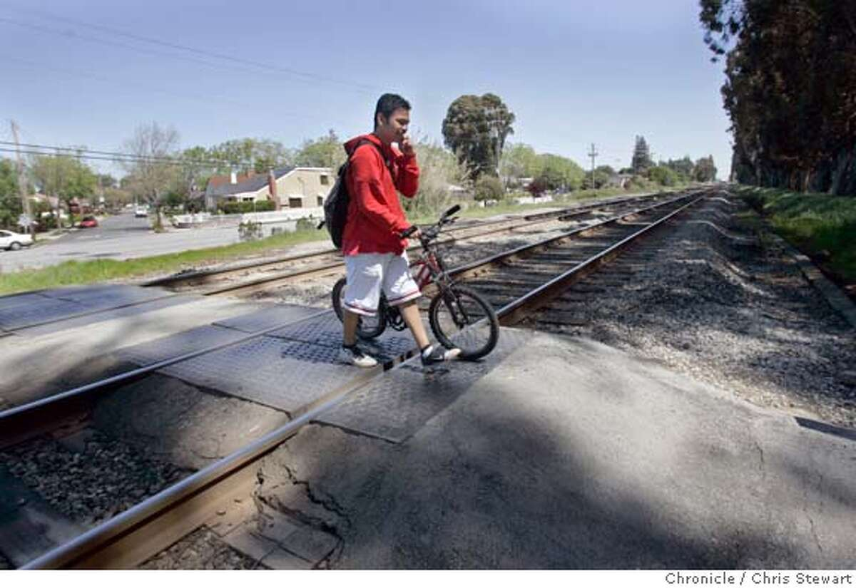 In this file photo. Roberto Cuevas, 17, a Burlingame High School student, makes a legal crossing of CalTrain tracks near Carolan and Morrell avenues in Burlingame.