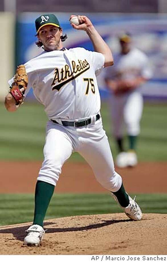 Oakland Athletics' Barry Zito pitches to the Detroit Tigers in the first inning of a baseball game, Thursday, April 20, 2006, in Oakland, Calif. (AP Photo/Marcio Jose Sanchez) Photo: MARCIO JOSE SANCHEZ