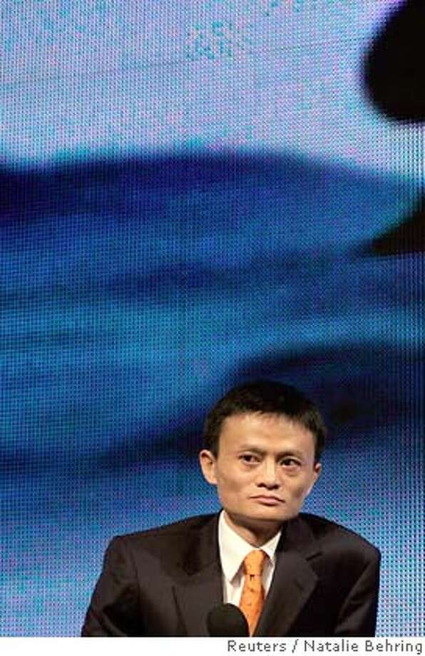 Jack Ma, the CEO of Alibaba.com listens as former U.S. president Bill Clinton speaks during the China Internet Summit in Hangzhou, China September 10, 2005. Yahoo Inc.'s newly acquired Alibaba.com unit will focus on building up several key businesses, but has no near-term plans for acquisitions or a public offering, as it aims to be China's Internet leader, top company executives said on Saturday. REUTERS/WCPV/Natalie Behring/Handout Ran on: 09-24-2005  Jack Ma, CEO of Alibaba.com, now something of an Internet celebrity in China, was one of the big stars at the China Internet Summit in his hometown, Hangzhou. 0 Photo: HO