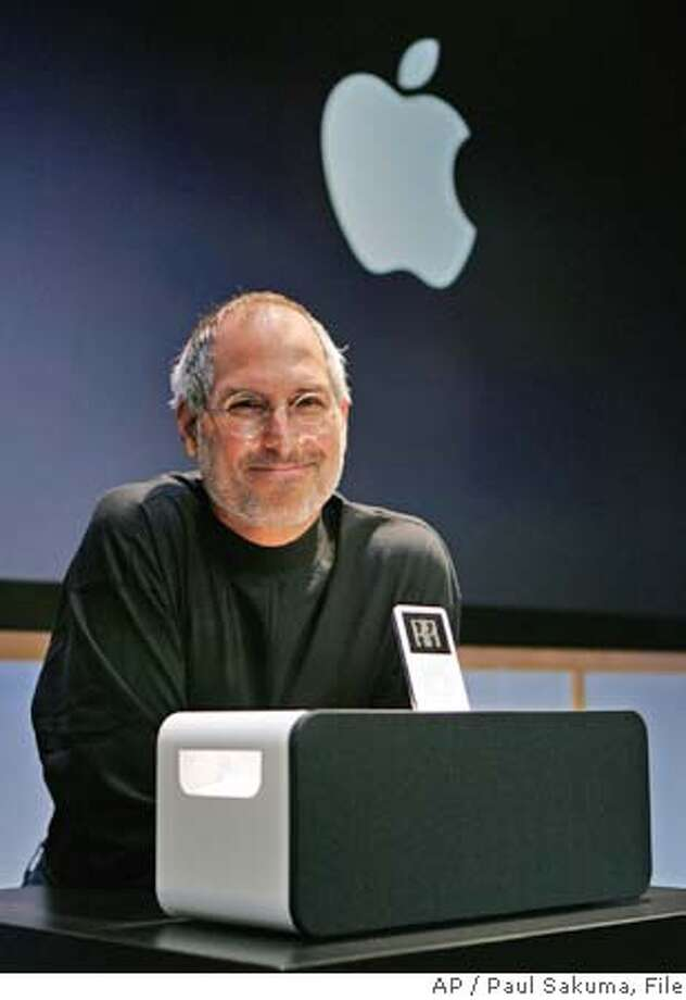 ** ADVANCE FOR SUNDAY MARCH 26 **FILE**Apple Computer Inc. CEO Steve Jobs smiles next to the new Apple iPod Hi-Fi speaker system for its iPod player at an unveiling at Apple headquarters in Cupertino, Calif., Tuesday, Feb. 28, 2006. As the storied company celebrates its 30th birthday in a week, Apple Computer Inc. will be showing its age: It will have brushed off its bruises from product failures and arguably misguided decisions to emerge with a shine that's more than skin-deep. Its luster now is brighter than ever, but for all of its recent successes, Apple also has its share of challenges ahead as it matures into a digital media provider. (AP Photo/Paul Sakuma)Ran on: 03-28-2006  Apple chief Steve Jobs has uncanny similarities to a character in his half-sister's new book, &quo;A Regular Guy.&quo; ** ADVANCE FOR SUNDAY MARCH 26 **FEB 28 2006 FILE PHOTO Photo: PAUL SAKUMA