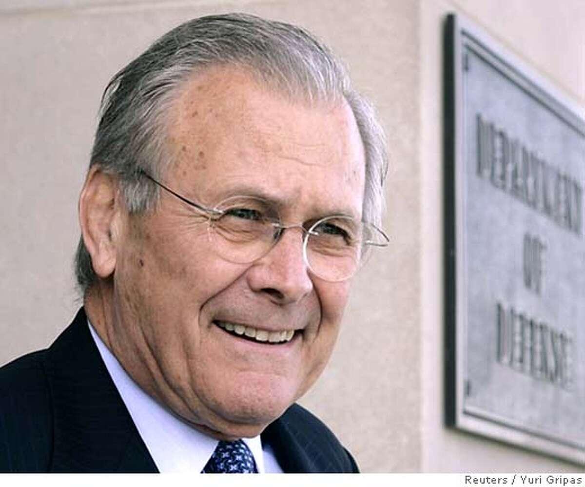 U.S. Secretary of Defense Donald Rumsfeld waits to welcome Tunisia's Defense Minister Kamel Morjane at the Pentagon in Washington April 19, 2006. REUTERS/Yuri Gripas
