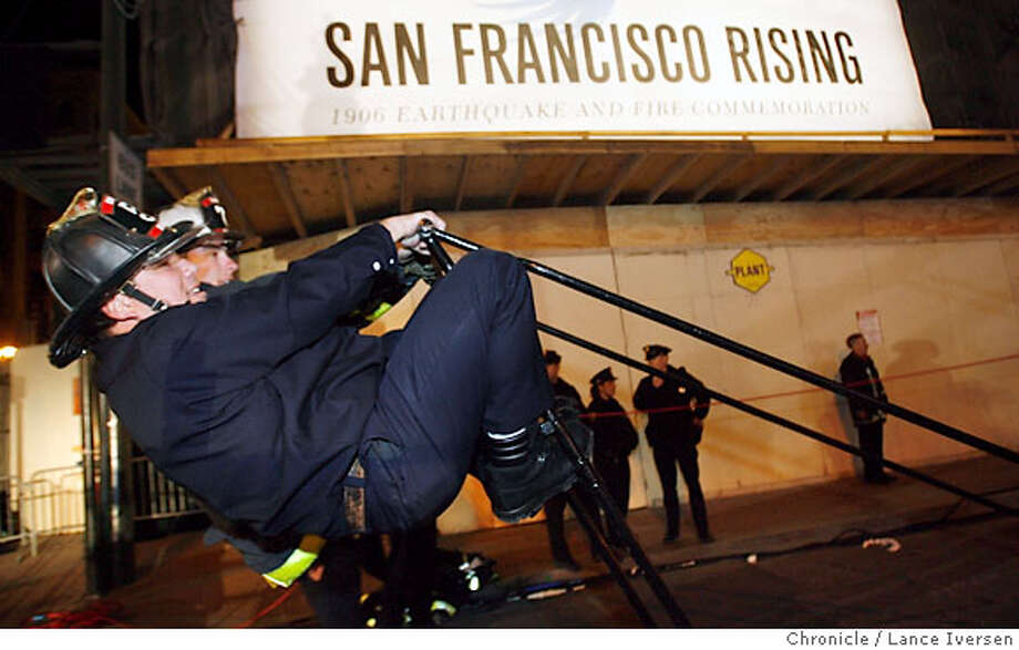 QUAKE_0050.jpg_  San Francisco fireman Dave Saitz and Tony Molloy counter balance a 65ft ladder used in the Great Quake period. At the time this was the largest ground ladder that could reach five stories. San Francisco celebrated and mourned an infamous anniversary early Tuesday morning 100 years to the minute after the City and surrounding bay-Area shook in the great earthquake of 1906, as thousands packed downtown streets around Lotta's Fountain. By Lance Iversen/San Francisco Chronicle Photo: Lance Iversen