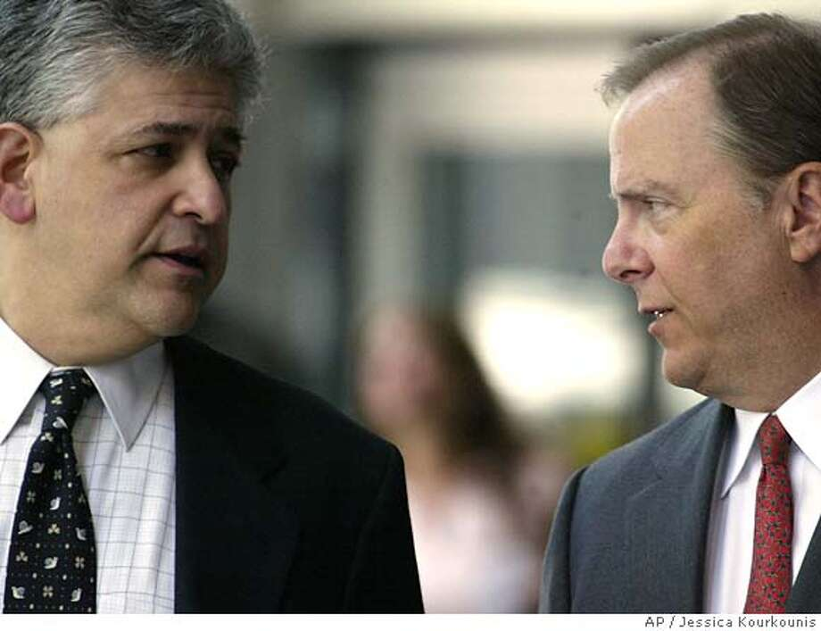 Former Enron CEO Jeff Skilling, right, and his attorney Daniel Petrocelli, left, leave the federal courthouse for lunch Tuesday, April 18, 2006 in Houston. Skilling continues to take the stand today during cross examination by the prosecution. Skilling and Enron founder Ken Lay are facing fraud and conspiracy charges. (AP / Jessica Kourkounis)