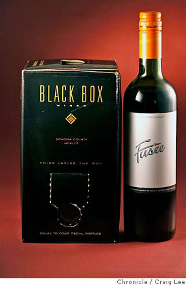 BARGAIN13_052_cl.JPG  For Bargain Wines column. Photo of NV Black Box Wines Sonoma County Merlot (left) and 2004 Fusee California Merlot (right). Craig Lee / The Chronicle MANDATORY CREDIT FOR PHOTOG AND SF CHRONICLE/ -MAGS OUT Photo: Craig Lee
