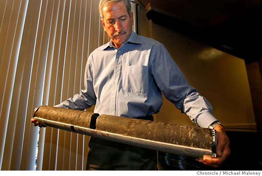 Mark Zoback of Stanford's Geophysics Department holds a section of the rock samples taken from two miles below the surface of the San Andreas Fault.  Earthquake scientists who have been running a major project at Parkfield, CA drilling two miles deep directly across the San Andreas Fault have brought up the first core samples altered by an active earthquake zone. They showed the rocks and described the successful project in a press conference at Stanford, CA on 10/4/07.  Photo by Michael Maloney / San Francisco Chronicle  ***Mark D. Zoback MANDATORY CREDIT FOR PHOTOG AND SF CHRONICLE/NO SALES-MAGS OUT Photo: Michael Maloney