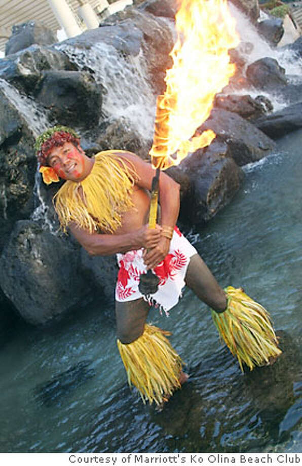 "TRAVEL HAWAII -- The chief dancer in the Samoan cultural show ""Fia Fia!"" at Marriott's Ko Olina Beach Club on the west side of Oahu wields a torch for the traditional Samoan fire dance. Photo courtesy Ko Olina Beach Club Photo: HO"