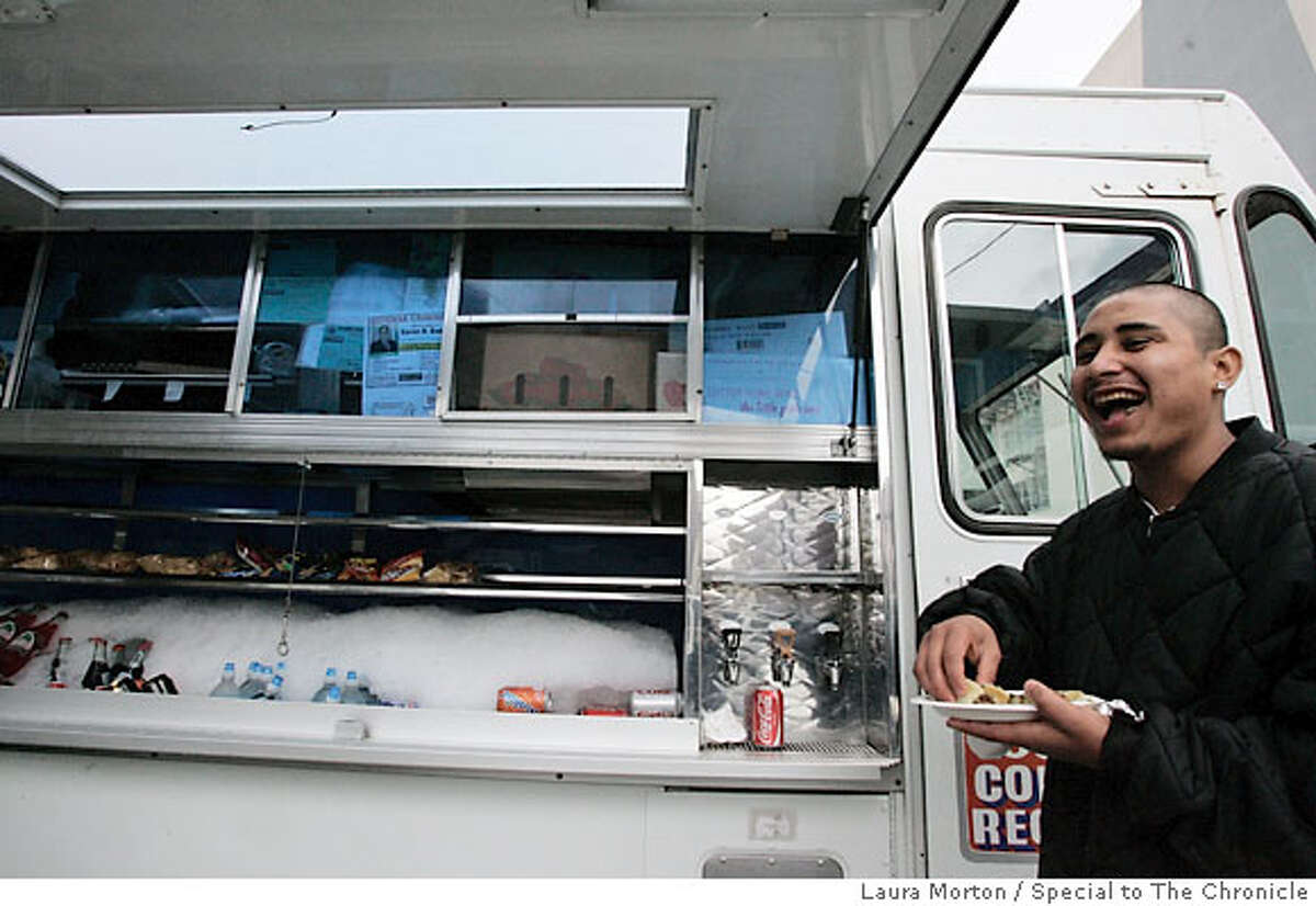 BARGAIN04_0072_LKM.jpg Jorge Sandoval laughs with his friends while eating lunch from the El Norteno taco truck. The truck caters to the lunchtime crowd and is parked in a lot off Bryant St. between 6th and 7th streets in San Francisco. (Laura Morton/Special to the Chronicle) *** Jorge Sandoval