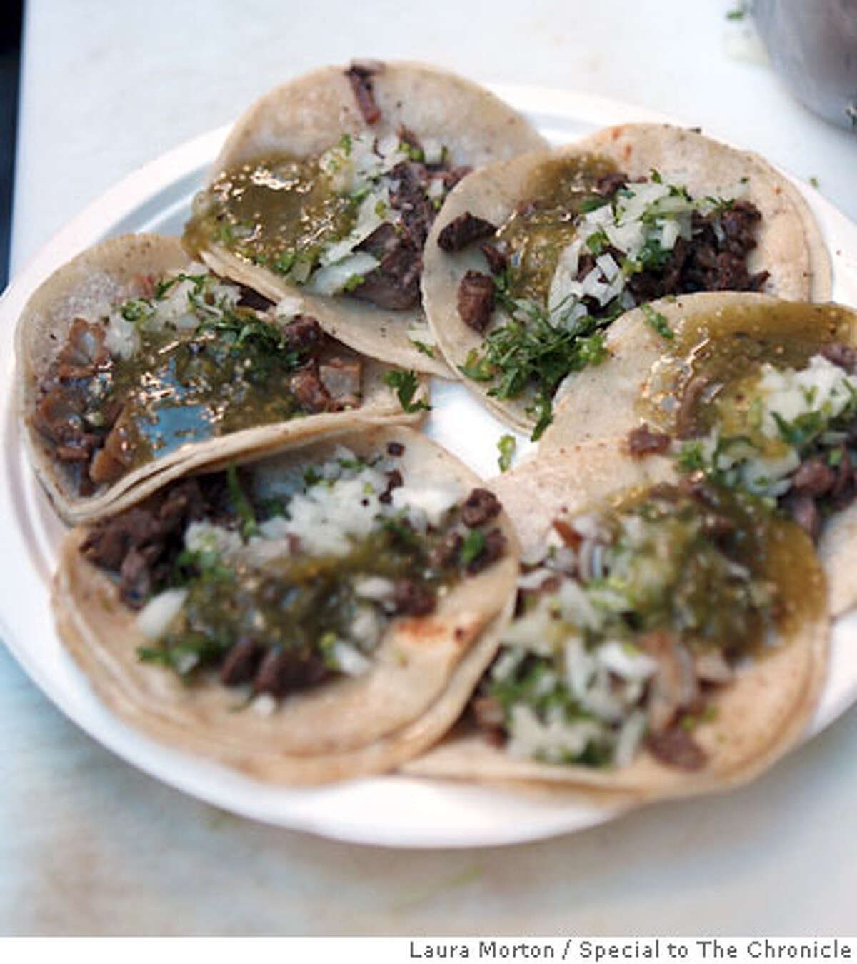 BARGAIN04_0180_LKM.jpg Tacos from the El Norteno taco truck, which parks in a lot off Bryant St. between 6th and 7th Streets in San Francisco. (Laura Morton/Special to the Chronicle)
