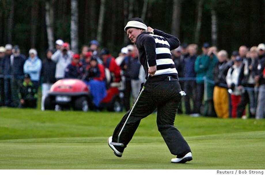 Norway's Suzann Pettersen celebrates after sinking a putt on the 12th green during a match against the U.S. at the Solheim Cup golf tournament in Halmstad September 15, 2007. REUTERS/Bob Strong (SWEDEN) 0 Photo: BOB STRONG