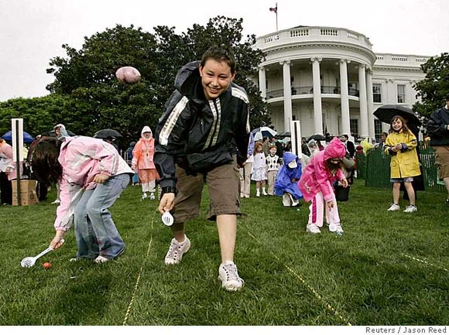 Children take part in annual White House Easter Egg Roll in Washington Photo: JASON REED
