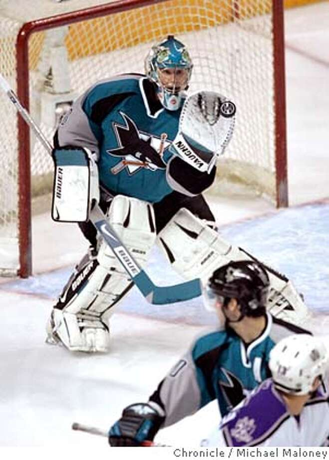 SHARKS_109_MJM.jpg  Sharks goalie Evgeni Nabokov catches a shot on goal in the 1st period.  San Jose Sharks vs Los Angeles Kings at the HP Pavillion.  Photo by Michael Maloney / San Francisco Chronicle on 4/17/06 in SAN JOSE,CARan on: 04-18-2006  Evgeni Nabokov makes a save for the Sharks against the Kings on Monday night. Photo: Michael Maloney
