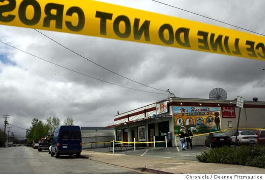 Three people were killed during a shooting spree in Headquarter's Bar in Redwood City early this morning. The bar is connected to Mi Hacienda restaurant.  Event was shot on 4/15/06 in Redwood City.  San Francisco Chronicle photo by Deanne Fitzmaurice Photo: Deanne Fitzmaurice