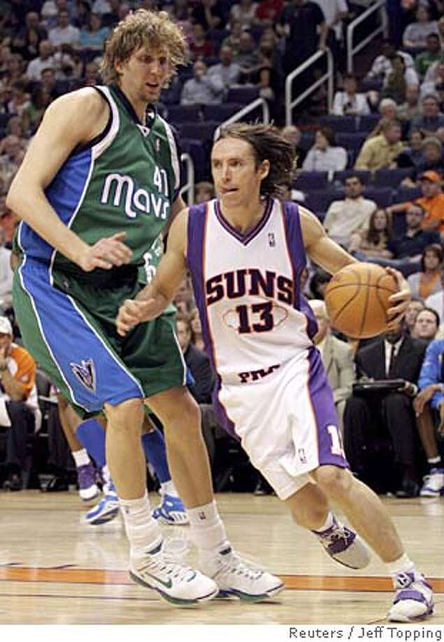 Phoenix Suns guard Steve Nash (13) of Canada drives past Dallas Mavericks center Dirk Nowitzki (41) during fourth quarter NBA action in Phoenix, Arizona, April 13, 2006. Nash had 13 assists in the game. Phoenix beat Dallas 117-104. REUTERS/Jeff Topping 0 Photo: JEFF TOPPING