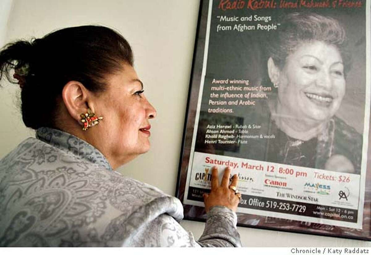 MAHWASH05_076_RAD.jpg SHOWN: Ustad Farida Mahwash is one of Afghanistan's greatest singers. She is looking at an old concert poster in her house in Fremont, CA. (Katy Raddatz/The Chronicle) ** Mandatory credit for the photographer and the San Francisco Chronicle. No sales; mags out.