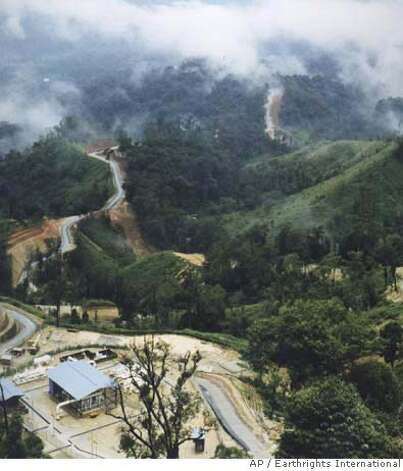 This undated photo released by Earthrights International shows Unocal Corp.'s $2.1 billion Yadana pipeline winding its way through the mountains of Myanmar in this undated photo. Multinational corporations based in the United States could change the way they conduct overseas business based on the pending settlement of human rights lawsuits against oil giant Unocal Corp. (AP Photo/Earthrights International) UNDATED HANDOUT PHOTO. NO SALES Photo: Anonymous