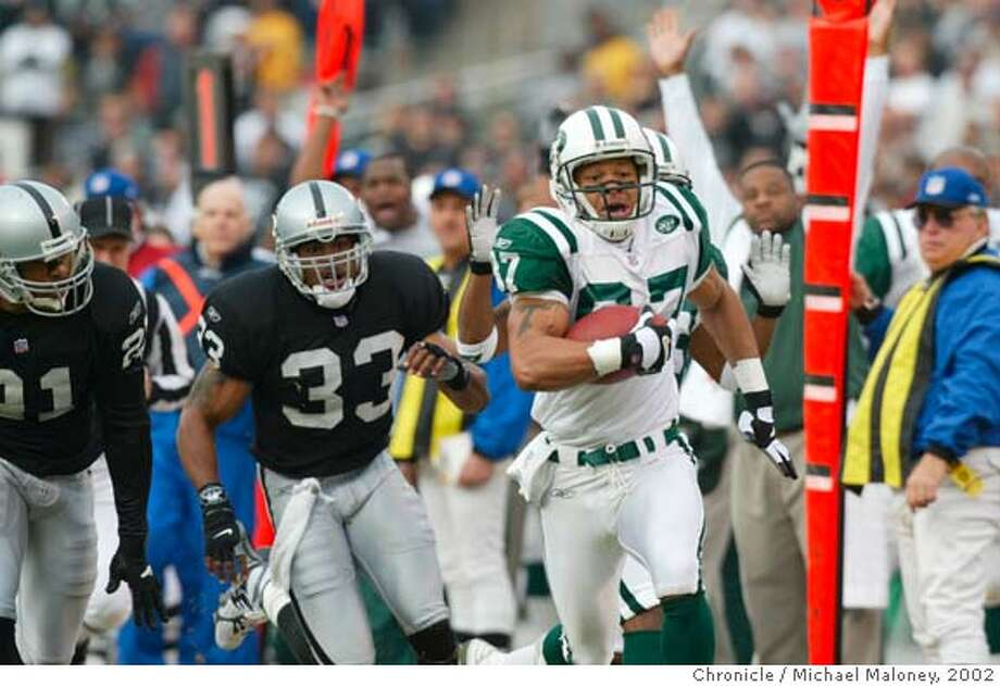 RAIDERSD-C-06JAN02-SP-MM Testaverde hit Laveranues Coles for a touchdown reception on the second play of the game. Eric Allen and Anthony Dorsett pursued. The Oakland Raiders take on the New York Jets on Sunday, January 6, 2002 at Network Associates Coliseum. Michael Maloney/The Chronicle CAT Photo: Michael Maloney