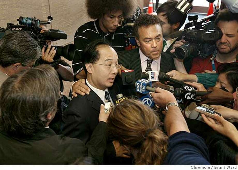 Ed Jew and lawyer Bill Fazio faced the media after his appearance in court Monday.  Ed Jew, the embattled San Francisco Supervisor was arraigned Monday morning at the Hall of Justice on several counts alleging he did not live within his district and then lied about it.  He was met by over 100 supporters who voiced their support outside the Hall of Justice.  {Brant Ward/San Francisco Chronicle}7/16/07 Photo: Brant Ward