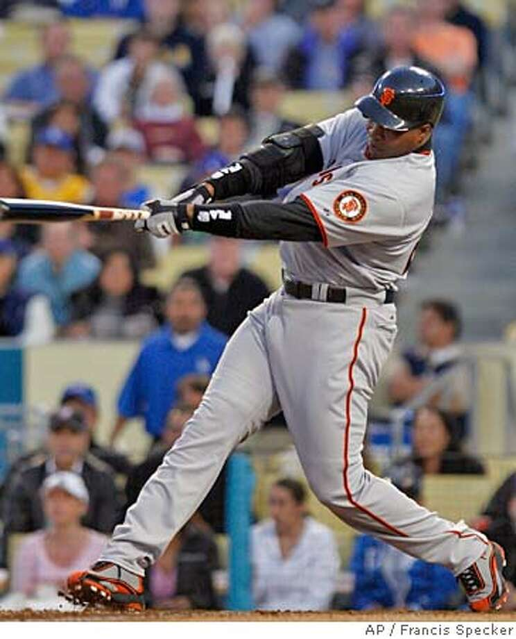 San Francisco Giants' Barry Bonds lines out to right field in the first inning of a baseball game against the Los Angeles Dodgers in Los Angeles on Saturday, April 15, 2006.(AP Photo/Francis Specker) Photo: FRANCIS SPECKER