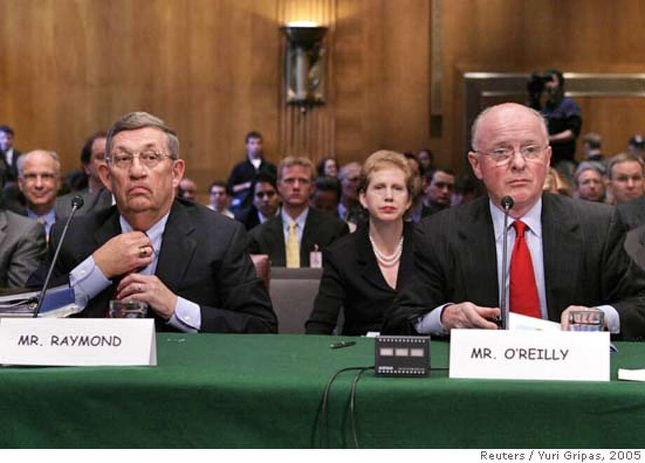 Exxon Mobil and Chevron corporations chairmen testify on Capitol Hill Photo: YURI GRIPAS