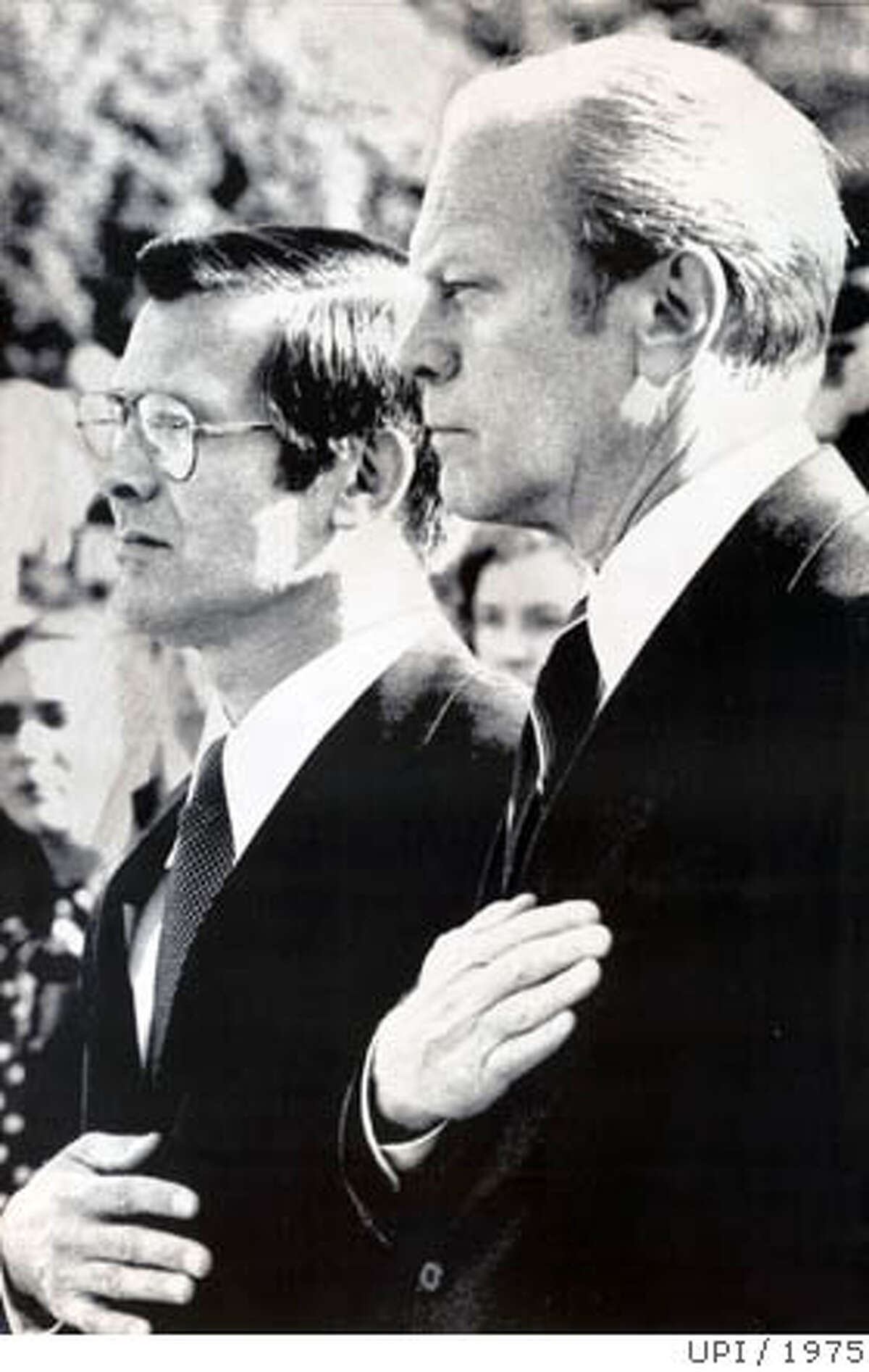 31days16.jpg President Gerald Ford, right, at the swearing-in ceremony for Secretary of Defense Donald Rumsfeld, left, on November 20, 1975. Rumsfeld, former White House chief of staff, was nominated after Ford dismissed James R. Schlesinger. PHOTO CREDIT: UPI