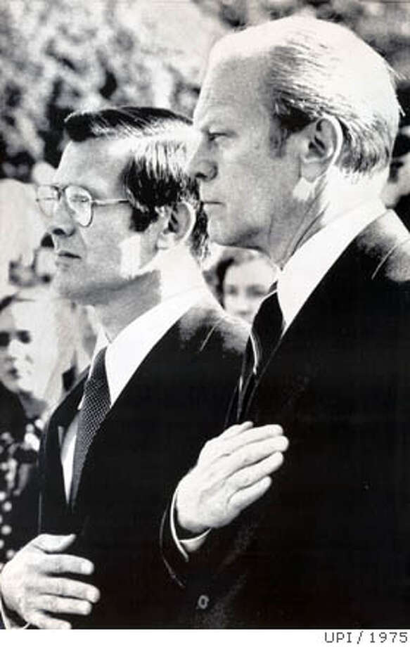 31days16.jpg President Gerald Ford, right, at the swearing-in ceremony for Secretary of Defense Donald Rumsfeld, left, on November 20, 1975. Rumsfeld, former White House chief of staff, was nominated after Ford dismissed James R. Schlesinger. PHOTO CREDIT: UPI Photo: UPI 1975