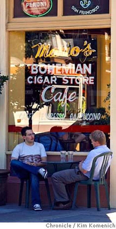 NORTHBEACH03_017_KK.JPG  (L to R, Alex Sanchez and Jake Nicol, seated in front of Mario's' Bohemian Cigar Store at Union and Columbus, react to news that San Francisco's North Beach has been designated as one of the US's Ten Great Neighborhoods by the American Planning Association. Photo by Kim Komenich/The Chronicle  ** TK TK MANDATORY CREDIT FOR PHOTOG AND SAN FRANCISCO CHRONICLE. NO SALES- MAGS OUT. Photo: Kim Komenich