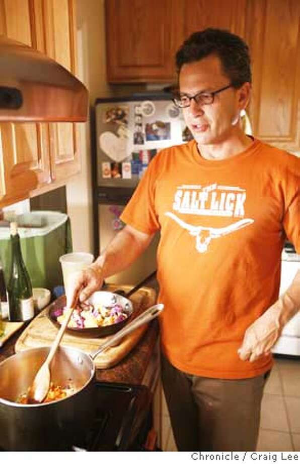 """CHEF26_057_cl.JPG  Photo of Chef Brad Levy at home cooking for his family. This is for a column about chefs cooking at home on their night off. Brad is cooking """"Brad's Mom's Chicken with White Wine and Mushrooms, Braised Farro, and Orange and Purple Cauliflower.  on 9/17/07 in San Francisco. photo by Craig Lee / The Chronicle MANDATORY CREDIT FOR PHOTOG AND SF CHRONICLE/NO SALES-MAGS OUT Photo: Photo By Craig Lee"""