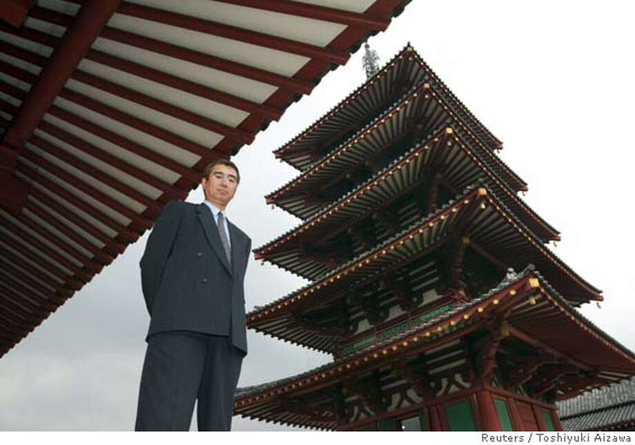 HEAD OF JAPANESE CONSTRUCTION FIRM IN FRONT OF GOLDEN TEMPLE Photo: TOSHIYUKI AIZAWA