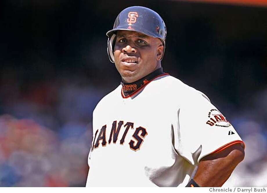 giants14_0012_db.JPG  Giants Barry Bonds stands on first base after his only hit of the game in 7th inning vs. Houston in the first game of a double header. San Francisco Giants vs. Houston Astros at AT&T park.  Event on 4/13/06 in San Francisco.  Darryl Bush / The Chronicle Photo: Darryl Bush