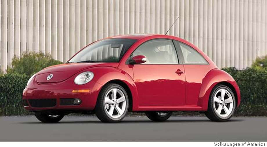 WHEELS BEETLE: The 2006 Volkswagen New Beetle 2.5 coupe _ a bulbous front-engine, front-wheel-drive iteration of its rear-engine, rear-wheel-drive predecessor _ putters passionately, even if it is shaped like an egg. Illustrates WHEELS-BEETLE (category l), by Warren Brown � 2006, The Washington Post. Moved Friday, April 7, 2006. (MUST CREDIT: Volkswagen of America.) Photo: Warren Brown