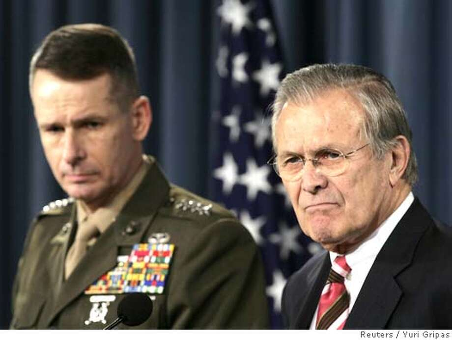 U.S. Secretary of Defense Donald Rumsfeld (R) and General Peter Pace, Chairman of the Joint Chiefs of Staff, listen to a journalist's question during a joint news briefing at the Pentagon in Washington April 11, 2006. REUTERS/Yuri Gripas 0 Photo: YURI GRIPAS