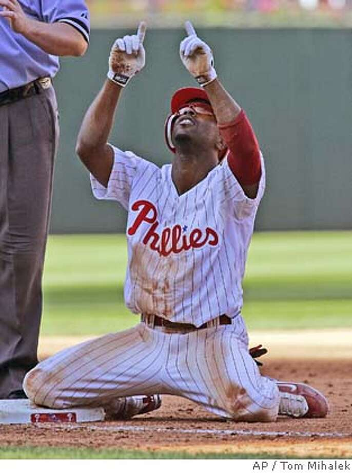 Philadelphia Phillies' Jimmy Rollins points skyward after hitting a triple in the sixth inning of a baseball game with the Washington Nationals, Sunday, Sept. 30, 2007, in Philadelphia. The Phillies won 6-1 taking the Eastern Division Championship.(AP Photo/Tom Mihalek) Photo: Tom Mihalek
