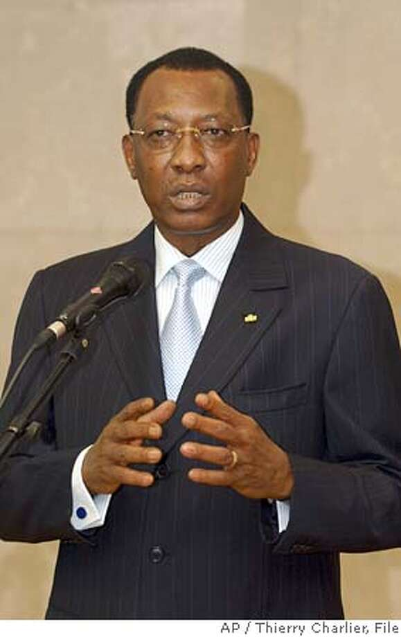 **FILE**Chad's President Idriss Deby gestures while talking during a press conference at the EU Commission headquarters in Brussels, in a Thursday Nov. 24, 2005 file photo. Government troops using tanks and attack helicopters repelled a rebel assault on Chad's capital Thursday, April 13, 2006. President Deby assured residents he remained in control. (AP Photo/Thierry Charlier, File) Photo: THIERRY CHARLIER