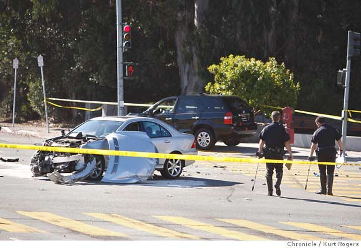 Police investigate a two car accident that closed 19th ave and Sloat Boulevard in San Francisco . CRASH_0088_KR.jpg Kurt Rogers / The Chronicle Photo taken on 10/2/07, in San Francisco, CA, USA