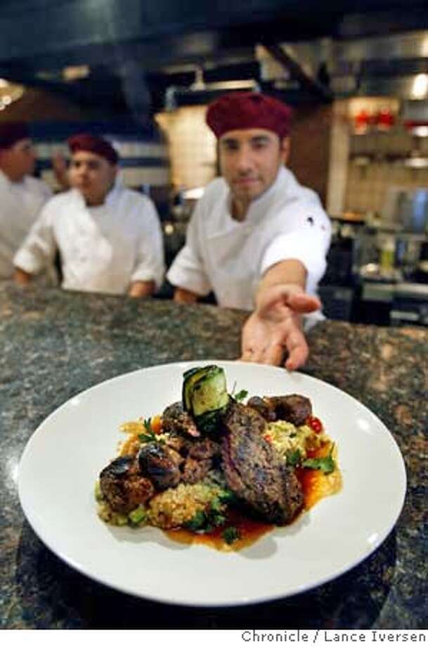 WHATS03_sens_68935.JPG  Line Chef Padro Ruiz offers up Herb Grilled Beef Filet & Kefta Kebab at Sens restaurant on the Promenade Level of #4 Embarcadero Center in San Francisco. SEPTEMBER 28, 2007. Lance Iversen/The Chronicle (cq) SUBJECT 9/28/07,in SAN FRANCISCO.CA. MANDATORY CREDIT PHOTOG AND SAN FRANCISCO CHRONICLE/NO SALES MAGS OUT Photo: By Lance Iversen