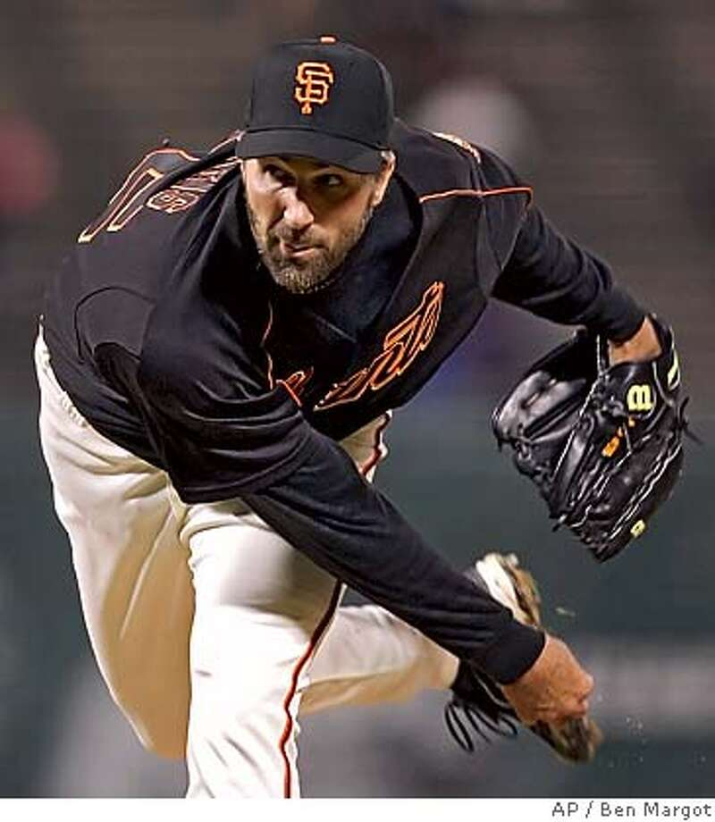 San Francisco Giants' Matt Morris follows through on a pitch to the Los Angeles Angels in the first inning of an exhibition baseball game Thursday, March 30, 2006, in San Francisco. (AP Photo/Ben Margot) EFE OUT Photo: BEN MARGOT