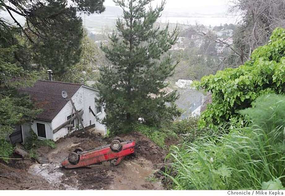 Mudslides on the 800 block of Humbolt Road in Brisbane destroyed a car and caused 3 homes to be exvacuated. Nobody was injured and Humbolt road is closed until further notice. Mike Kepka / The Chronicle Photo: Mike Kepka